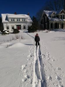 Milo skiing in the front garden